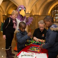Rochester Bridge Trust hosts a free Bridge Building Day in The Crypt at Rochester Cathedral, Rochester. From Left: Pictured are Daniel Simpeh, aged six & Winston Simpeh, aged eight, building a bridge with K'Nex. The Crypt, Rochester Cathedral, College Yard, Rochester, Kent. ME1 1SX.