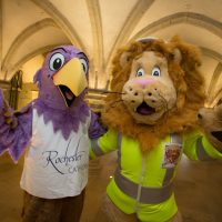 Rochester Bridge Trust hosts a free Bridge Building Day in The Crypt at Rochester Cathedral, Rochester. From Left: Pictured are Rochester Cathedral Mascot Eggie the Eagle & Rochester Bridge Trust Mascot Langdon the Lion. The Crypt, Rochester Cathedral, College Yard, Rochester, Kent. ME1 1SX.