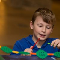 Rochester Bridge Trust hosts a free Bridge Building Day in The Crypt at Rochester Cathedral, Rochester. Pictured is Callum Wood, aged eight, building a bridge from K'Nex. The Crypt, Rochester Cathedral, College Yard, Rochester, Kent. ME1 1SX.