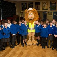 Rochester Bridge Trust hosts a Water Filter building day at St Helen's Church of England Primary School, Cliffe. Pictured are children from Year 5 at St Helen's Church of England Primary School, Cliffe with Langdon the Lion. St Helen's Church of England Primary School, Church Street, Cliffe, Rochester, Kent. ME3 7PU. Pictured: Andy Jones/Maxim PR