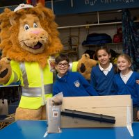 Rochester Bridge Trust hosts a Water Filter building day at St Helen's Church of England Primary School, Cliffe. Pictured are Team Six from Year 5 at St Helen's Church of England Primary School, Cliffe with Langdon the Lion. St Helen's Church of England Primary School, Church Street, Cliffe, Rochester, Kent. ME3 7PU. Pictured: Andy Jones/Maxim PR